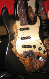 burnmethod, guitar, guitars, pyrography, custom, wood burning, engraved, strat, stratocaster, mountain, fantasy, moon, black, gold, lava, landscape, night, midnight