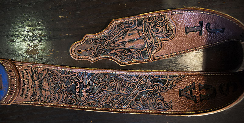 burnmethod, guitar, strap, pyrography, custom, wood burning, engraved, personalized, leather, outlaw, county, ace of spades, pistol, scrollwork, cow skull, skull, sparrow, initials, longhorn, inscription