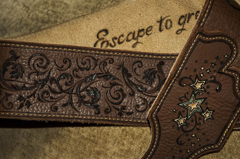 burnmethod, guitar, strap, pyrography, custom, wood burning, engraved, personalized, leather, vintage, brown, intricate, ornate, scrollwork, treble, clef, music, notes, victorian, stars